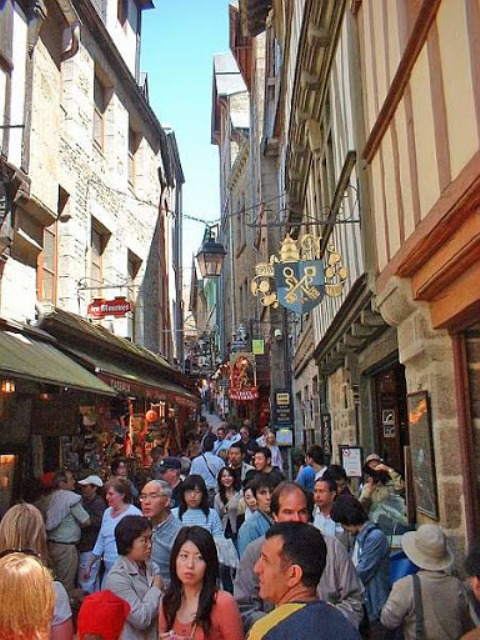 The narrow medieval bustling streets of Mont St Michel, Normandy, France